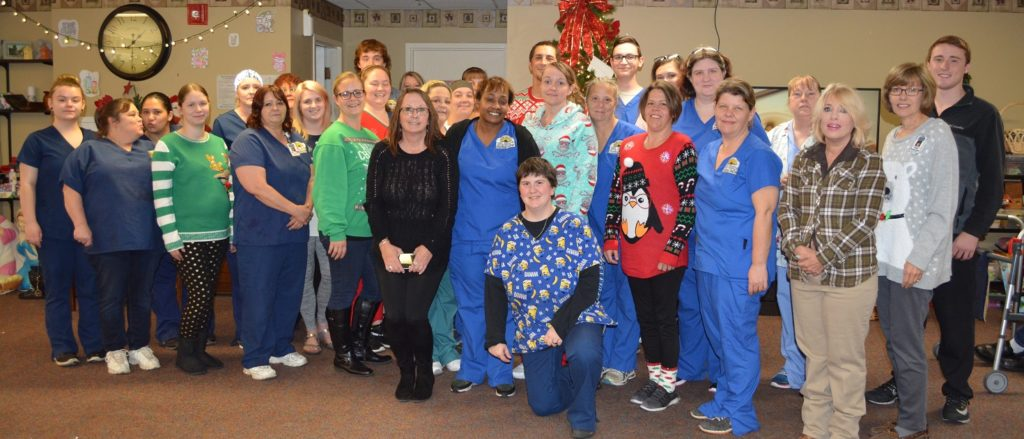 Team Christmas photo of nurses and staff of Kansas' Mount Hope Nursing Center