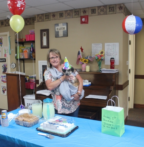 Jasper with staff and residents at his birthday party at Mount Hope