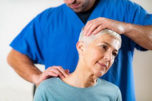 physical therapist stretching senior woman neck 300x200 - What is a Convalescent Home?